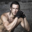 Handsome muscle athlete looking at camera — Stock Photo #31536103