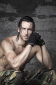 Handsome muscle athlete looking at camera — Stock Photo