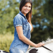 Portrait of beautiful young female rider sitting on her horse outside — Foto Stock