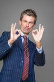 Satisfied businessman in ok gesture — Stock Photo
