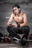 Handsome crouched athlete — Stock Photo