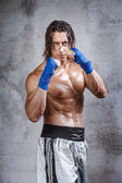 Very muscular boxer ready to fight — Stock Photo
