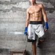 Handsome boxer man standing on the wall  — Stock Photo