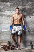 Handsome boxer man standing on the wall and looking at camera — Stock Photo