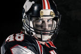 Cropped image of american football player — Stock Photo