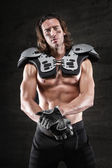 Bare chested american football player — Stock Photo
