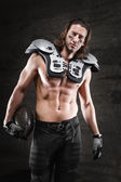 Handsome bare chested american football player — Stock Photo