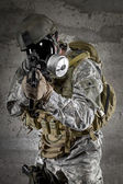 Gas Mask Soldier aiming rifle — Stock Photo