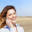 Happy attractive female laughing on the smart phone — Stock Photo #43759593