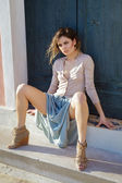 Outdoor portrait of Fashion model sitting on stairs — Foto de Stock
