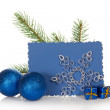 The fir-tree branch, two Christmas toys, small gift boxes, snowflake and the blue empty card isolated on white — Stock Photo