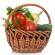 Stock Photo: Tomatoes, cucumbers, pepper and greens, in the wicker basket, isolated on white