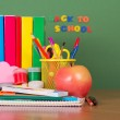Back to school. Textbooks and a set of school accessories on a table — Stock Photo #31673069