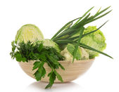 Cauliflower, white cabbage, the Chinese cabbage, green onions, parsley and dill in the bowl, isolated on white — Stock Photo