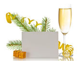 Champagne wine glass, pine branch with a serpentine, small gift boxes and the empty card isolated on white — Stock Photo