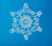 Нand made. Paper Christmas snowflake. On blue background — Photo