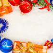 Colorful christmas frame on snow — Stock Photo