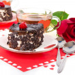 Chocolate cherry cakes, hot tea and red rose isolated on white — Stock Photo