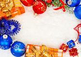 Colorful christmas frame on snow — Stock Photo