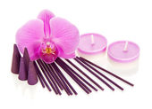 Orchid flower, aromatic sticks and cones, the candles isolated on white — Stock Photo
