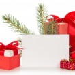 Fir-tree branch, Christmas toy, gift boxes and the empty card isolated on white — Stock Photo #32290685