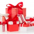 Bright colourful boxes with the gifts, decorated with ribbons and the bows — Stock Photo