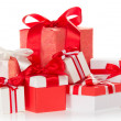 Bright colourful boxes with the gifts, decorated with ribbons and the bows — Stock Photo #32290239