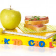 Set of school supplies, apple,sandwich on the striped napkin, isolated on white — Stock Photo