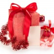 Different gift boxes with ribbons and bows, tinsel and empty card — Stock Photo