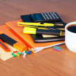 Organizer, exercise books, the handle, pencil, marker and the calculator on a table — Stock Photo