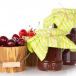 Different grades of sweet cherry in buckets and jars of jam isolated on white — ストック写真 #32291157