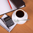Open notepad, organizer, empty sheets for notes a pencil, the handle, the calculator, cup of coffee on a table — Стоковая фотография
