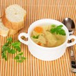 Transparent chicken broth with paste and vegetables on a bamboo cloth — Stock Photo