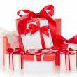Bright colourful boxes with the gifts, decorated with ribbons and the bows, isolated on white — Stock Photo #32291765