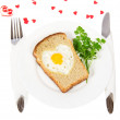 Festive a breakfast on Valentine's Day, fried egg in the form of heart, bread, decorative hearts isolated on white — Stock Photo