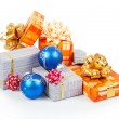 Christmas balls and gifts isolated on white — Stock Photo #32292031