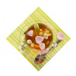 Flower tea and rose petals on the striped napkin — Stockfoto
