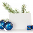 The fir-tree branch, two Christmas toys, small gift boxes, and the empty card isolated on white — Stock Photo