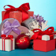 Various gift boxes and beautiful Christmas toys on a blue background — Stock Photo