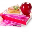 He book, stationery, sandwich with sausage, and the apple — Stockfoto