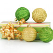 Christmas gift box with gold and green balls isolated on white — Stock Photo