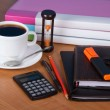 Notepad, organizer, marker, folders for documents the calculator, hourglasses and a cup of coffee on a table — Stok Fotoğraf #32293785