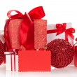 Gift boxes with tapes and bows, the spheres decorated with beads, empty card — Stock Photo