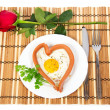 Festive a breakfast on Valentine's Day, sausage in the form of heart, red rose isolated on white — Stock Photo