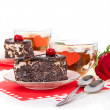 Romantic tea drinking with chocolate cakes and red rose isolated on white — Stock fotografie