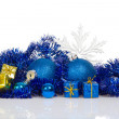 Blue christmas balls and blue, gold gift boxes, blue tinsel, snowflakes isolated on white — Stock Photo #32294343