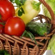 Tomatoes, pepper, cucumber, onions, in a basket, and cabbage nearby, a closeup — Stock Photo