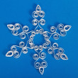 Zdjęcie stockowe: Snowflake with quilling on blue background. Stripe paper swirl