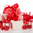Christmas gifts, toys, a tinsel and blank card — Stock Photo