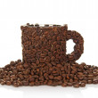 The coffee cup made of beans, costs on a small group of grains — Stok fotoğraf